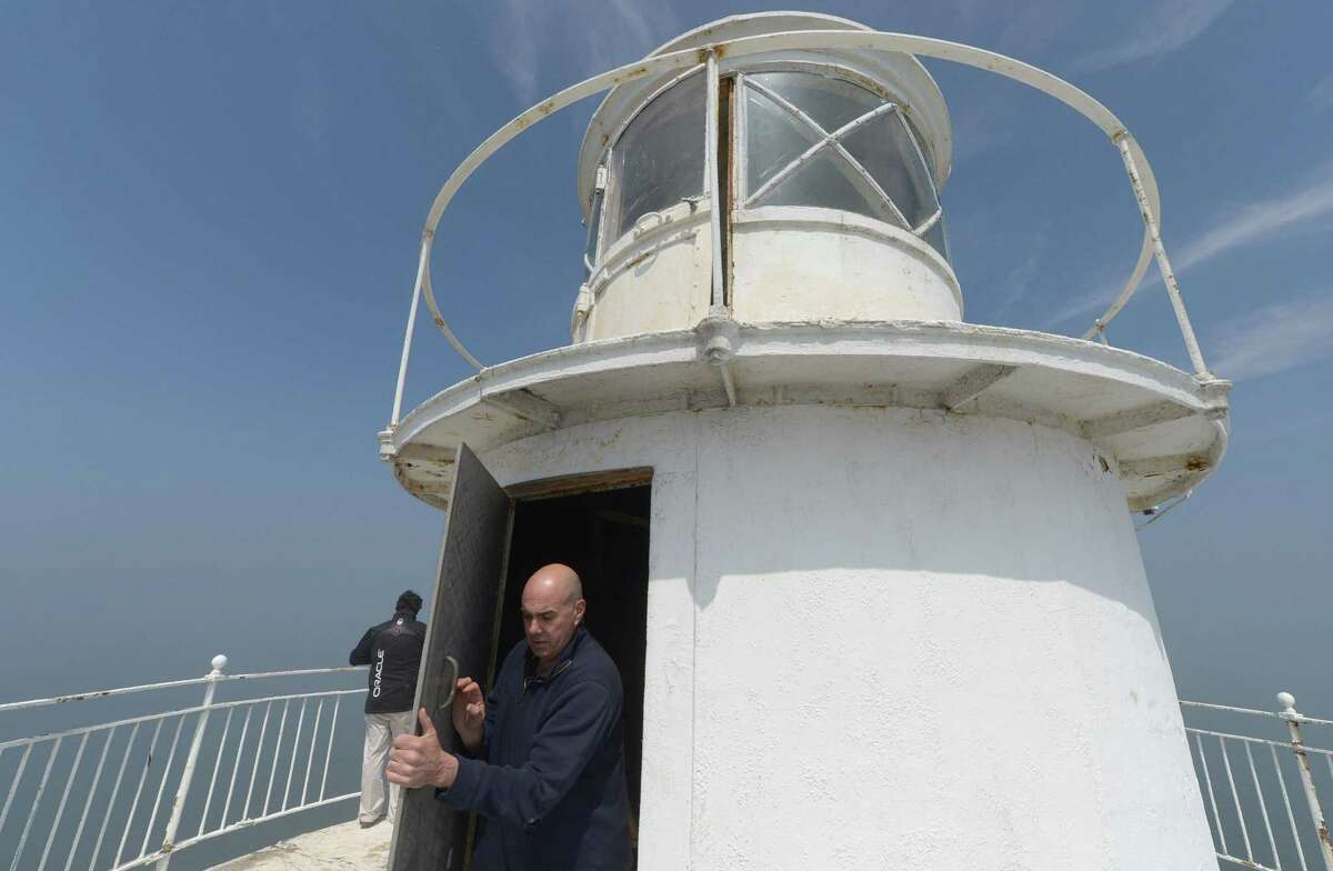 Rowayton resident, Founder and Executive Director of the Greens Ledge Light Preservation Society, Brendan McGee, and Society President, Tim Pettee, tour the Greens Ledge Lighthouse Friday, April 26, 2017, one mile off the coast of Rowayton in Norwalk, Conn. The U.S. General Services Administration New England revealed last month that Rowayton resident Tim Pettee and the Greens Ledge Light Preservation Society were awarded the lighthouse which was built at the turn of the twentieth century following the GSA auction in July last year.