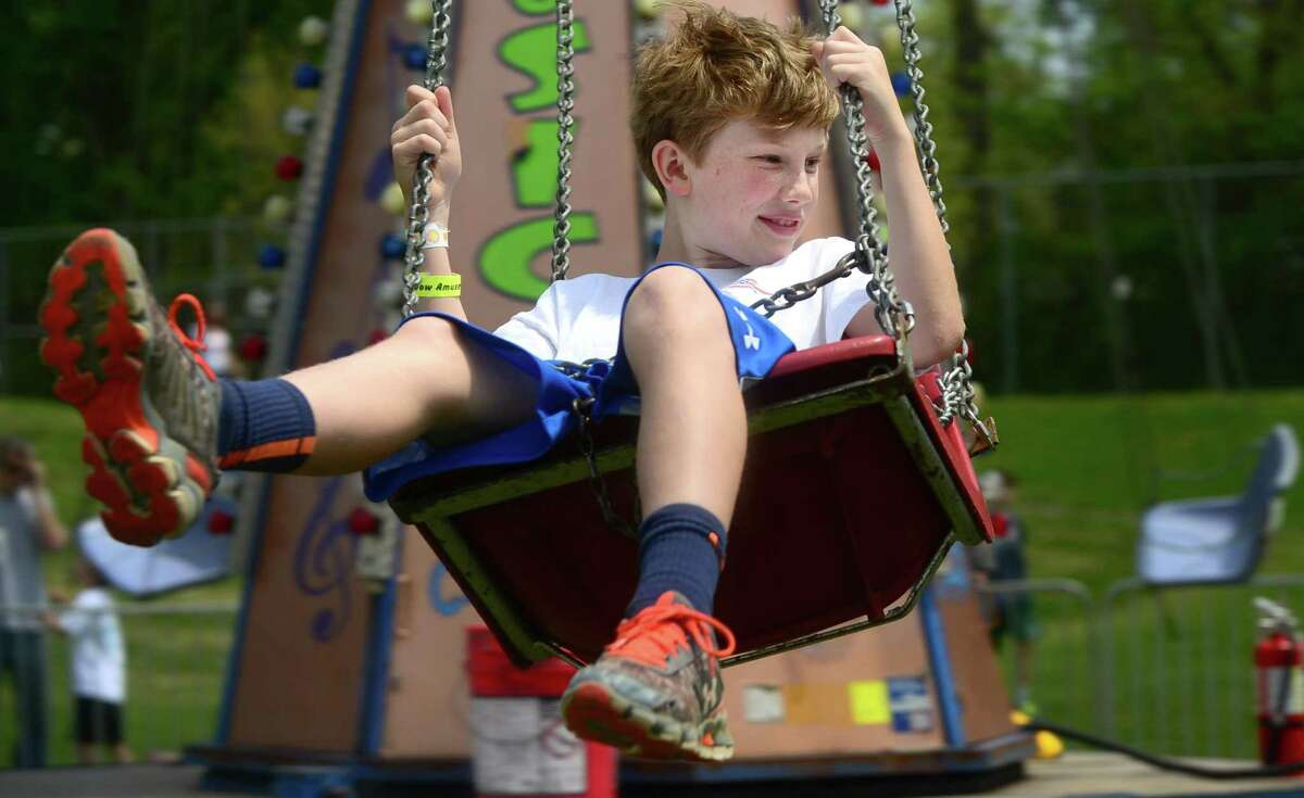 Eamon Boyle enjoys the rides during the 25th annual Rowayton School Carnival Saturday, May 14, at Rowayton Elementary School in Norwalk. The annual Rowayton School Carnival hits town this weekend, from May 12, from 5-10 p.m. to May 13, from 10 a.m. to 5 p.m.