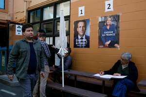 Emmanuel Macron and Marine Le Pen posters rest on the walls at Ecole Bilingue de Berkeley in Berkley, Calif. as french voters go to the voting booths in the final round of the country's presidential election on Saturday, May 6, 2017.