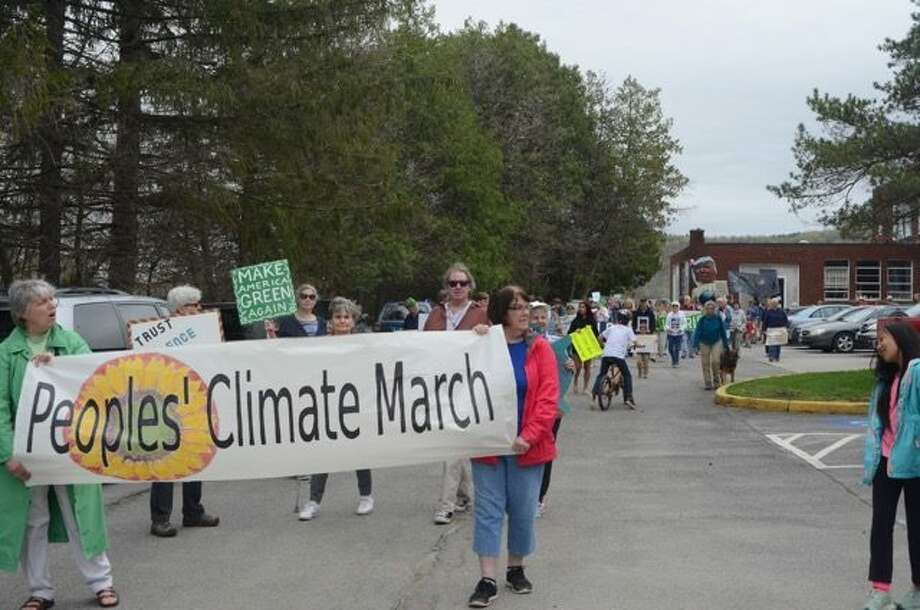 More than 120 people, from babies to senior citizens, turned out for the Peoples' Climate March in Cherry Valley Saturday, April 29. Marchers and walkers headed through the village bearing colorful banners, signs, and giant, handmade puppets (including Gaia, a butterfly, and a colorful banner of the sun). ORG XMIT: K1gAJkOZaNKvW18Iy1l3