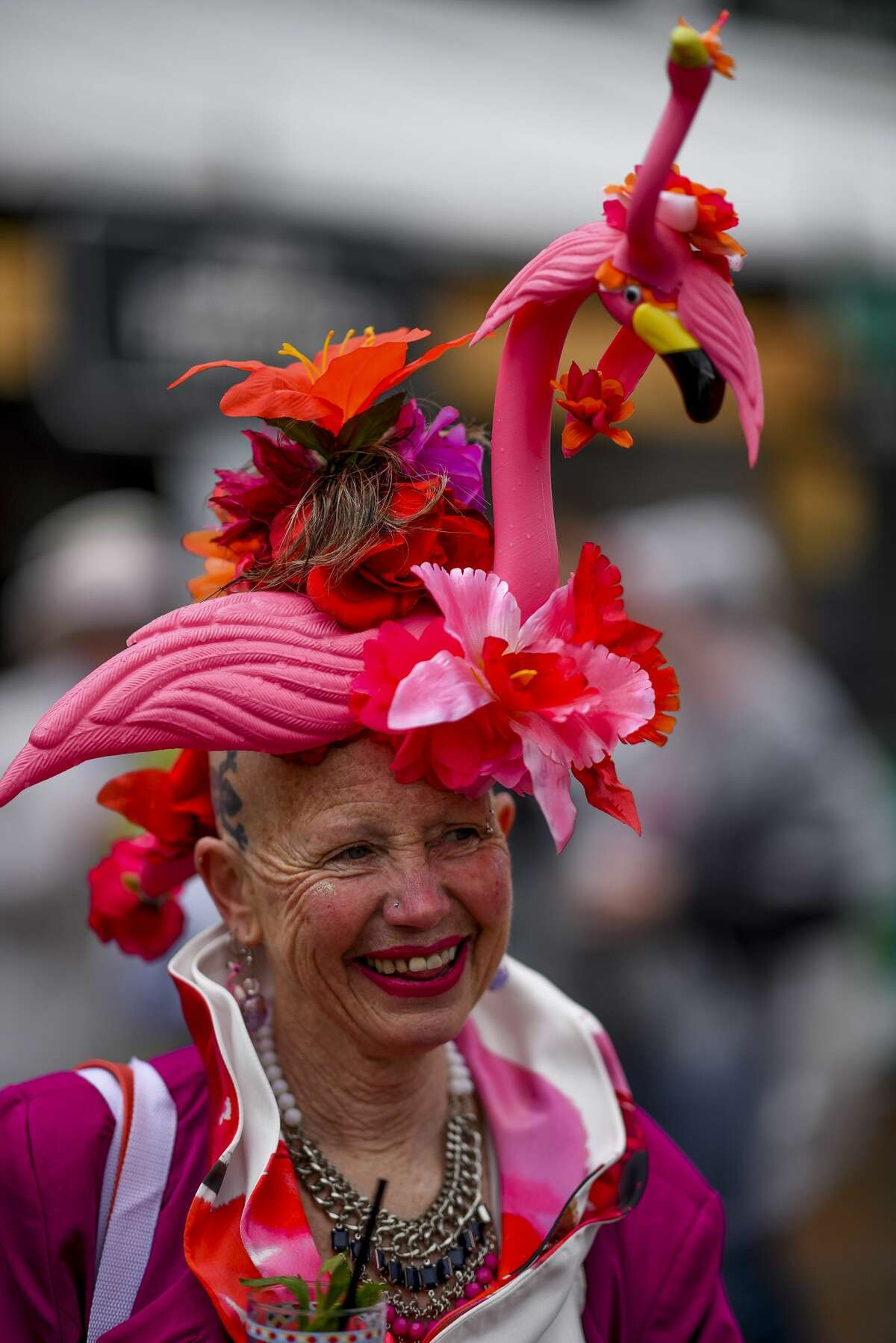 A woman wears a pink hat with a flamingo on it on Kentucky Derby Day at Churchill Downs on May 6, 2017 in Louisville, Kentucky.