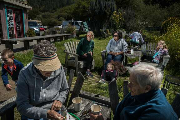 Jenner residents Amanda May and her mother Diane May enjoy the sun with kids Cameron, 5, Mile, 3 and Scarlett Higuera, 7 on Saturday, May 6, 2017 in Jenner, CA.  In the foreground is Jeanne Jullion and Robin Song who owns cabins here and Anna Caine carrying her daughter (not visible) Ayla, 10-months old.  There were drinking coffee from Cafe Aquatica 10439 Highway 1.
