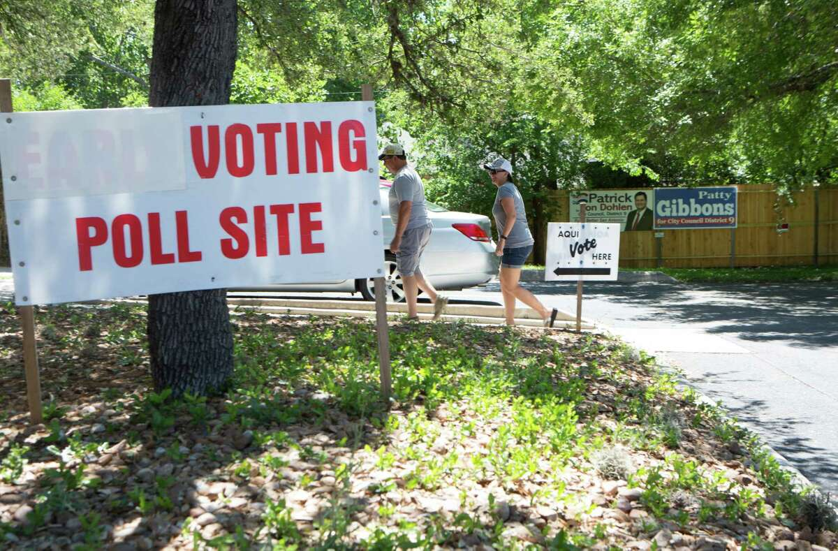 A husband and a wife enter the Brook Hollow branch of the San Antonio Library to vote during the General and bond Election in San Antonio, Texas on May 6, 2017.