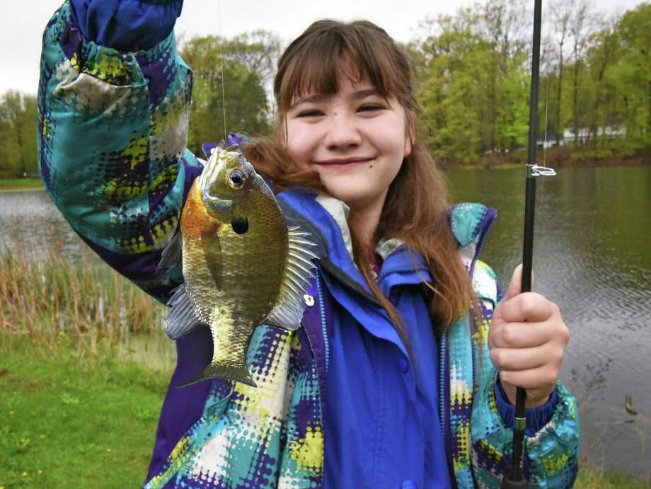 Ten-year-old Nancy Murphy of Clifton Park shows off a sunfish she caught during Learn to Fish Day at Barney Road Park Saturday May 6, 2017 in Clifton Park, NY.  (John Carl D'Annibale / Times Union) Photo: John Carl D'Annibale / 20039667A