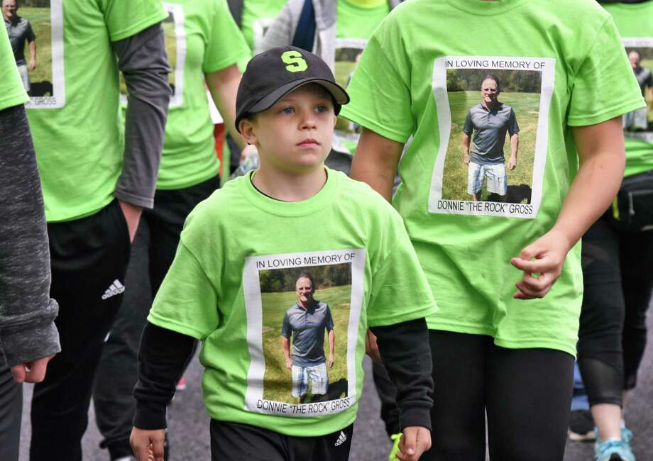 "Eight-year-old Keegan Oliveri of Rotterdam walks in the AmpUp! Walk to end bladder cancer in memory of his grandfather Donnie ""The Rock"" Gross Saturday May 6, 2017 in Niskayuna, NY.  (John Carl D'Annibale / Times Union) Photo: John Carl D'Annibale / 40040394A"