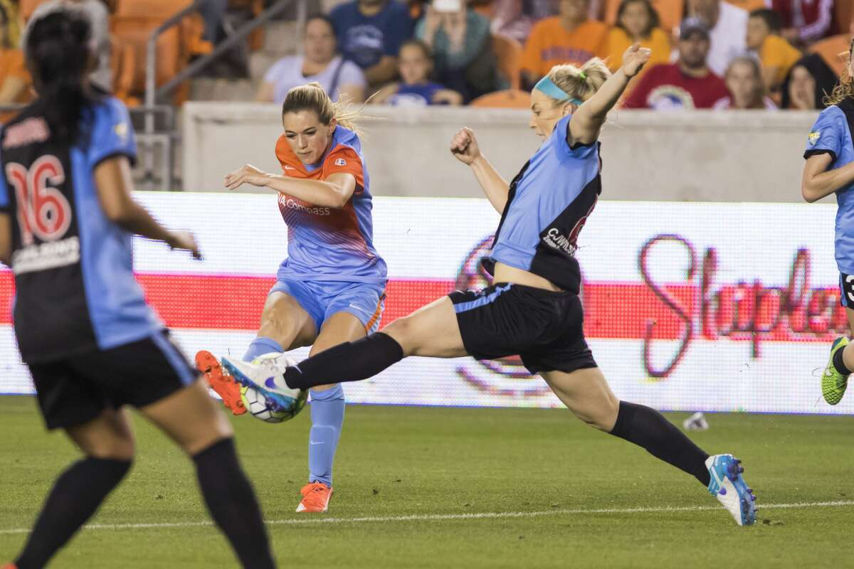 Dash forward Kelia Ohai (7) has her shot blocked by Red Stars defender Julie Johnston (8) in a National Women's Soccer League game at BBVA Compass Stadium on Saturday, April 16, 2016, in Houston,TX. ( Joe Buvid / For the Chronicle )