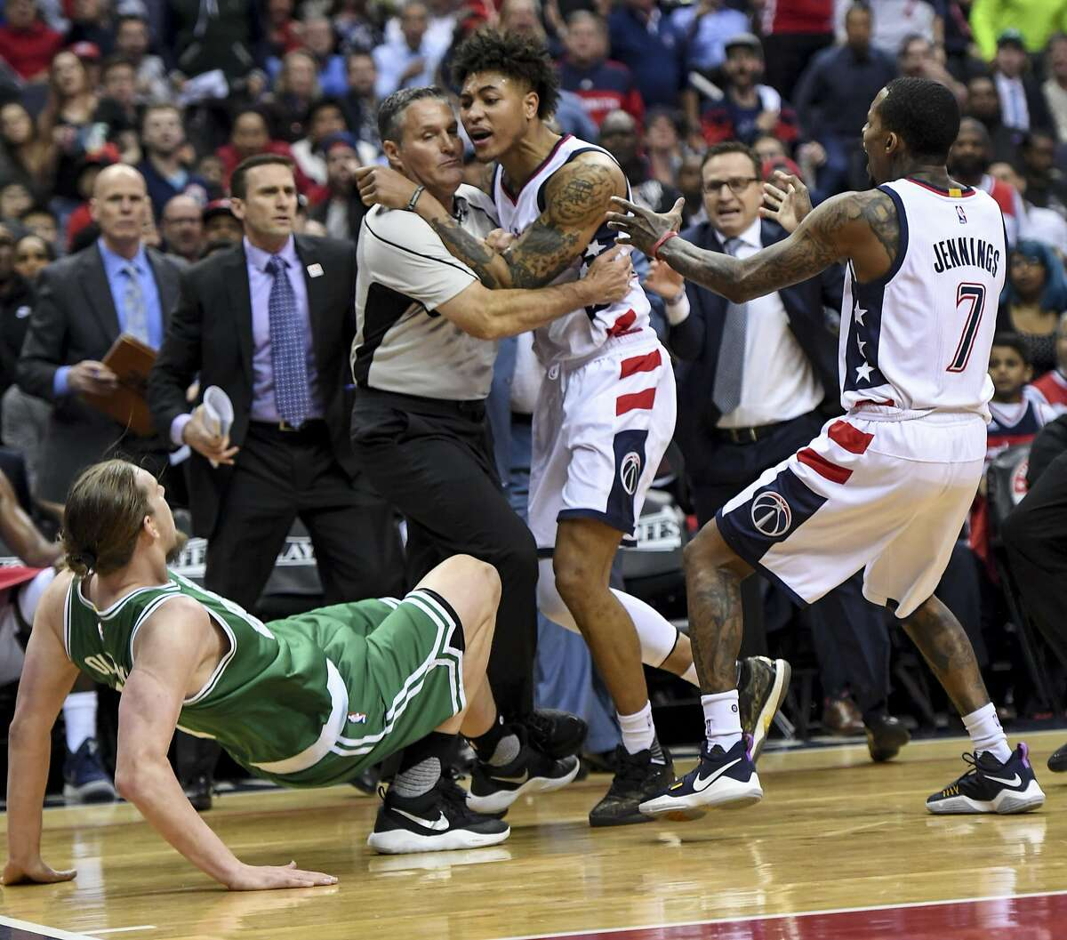 NBA referee Monty McCutchen holds back Wizards forward Kelly Oubre Jr. as he goes after Celtics center Kelly Olynyk during Game 3. Oubre was ejected from the game. Must credit: Washington Post photo by Jonathan Newton
