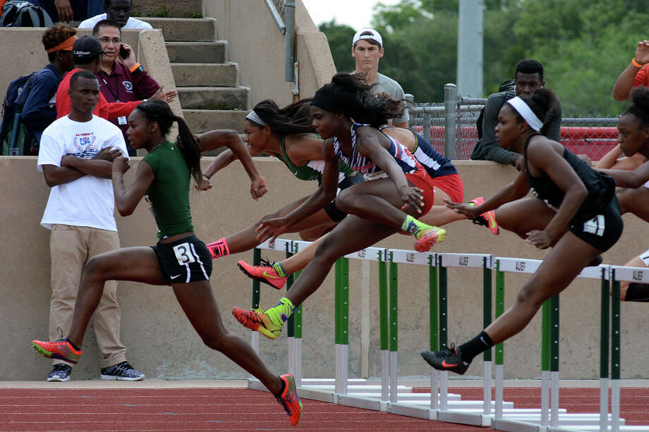 Mayde Creek sophomore Javlyn Cameron, left, leads the pack after the third hurdle during heat 1 of the Girls 100 Meter Hurdles during the running preliminaries at the 2015 Region III-6A Track & Field Championship at Crump Stadium in Alief on Friday, May 1, 2015. Photo: Jerry Baker, Freelance
