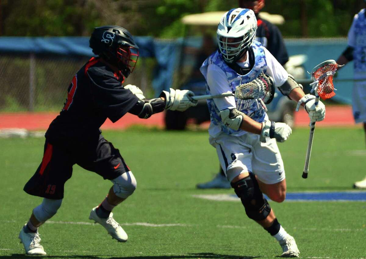 Boys lacrosse action between Staples and Stamford in Westport, Conn., on Saturday May 6, 2017.