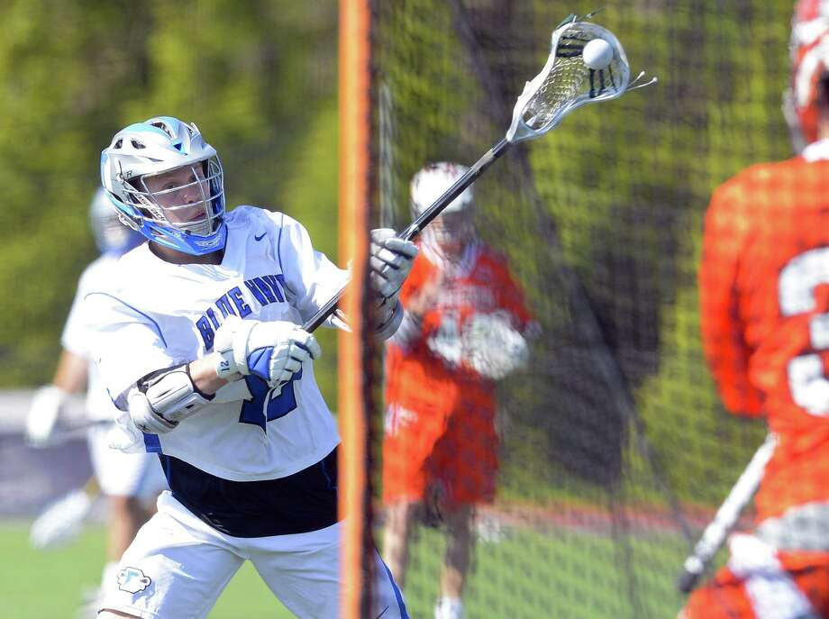 Darien Kevin Lindley (12) fires a shot past Ridgefield goalie Daniel Parson (31) for a second half score in a varsity boys lacrosse game at Darien High School on May 6, 2017. Darien defeated Ridgefield 10-3. Photo: Matthew Brown / Hearst Connecticut Media / Stamford Advocate