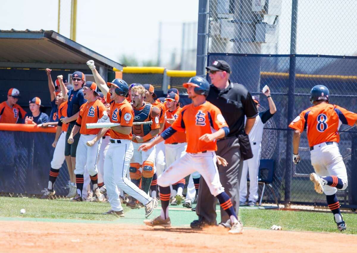 Seven Lakes players celebrate on the field after Keith Thompson hit the ball for three-runs during a high school baseball playoff game-2 between Ridge Point at Seven Lakes at SLHS - Baseball Field, Saturday, May 6, 2017, in Katy. Seven Lakes defeated Ridge Point 6-3. (Juan DeLeon/for the Houston Chronicle )
