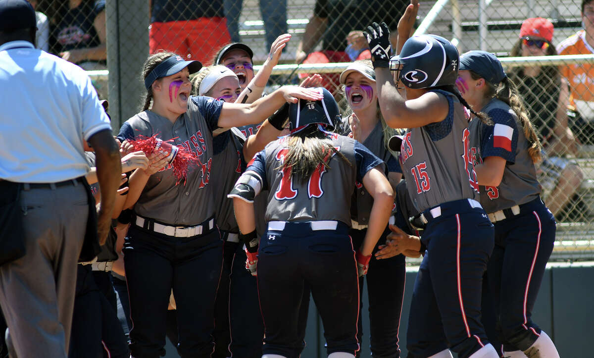 Pearland Dawson sophomore Courtney Day, center, is greeted at home plate by her teammates after hitting a homerun in the bottom of the first inning against Atascocita during their Region III-6A Area Round Softball Playoff series at Pearland Dawson High School on Saturday, May 6, 2017. (Photo by Jerry Baker/Freelance)