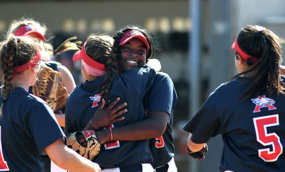 Atascocita senior pitcher Tierrah Williams, center, shares a hug with senior third baseman Sarah Cedillo after finishing the Lady Eagles 4-3 win over Pearland Dawson in game 2 of their Region III-6A Area Round Softball Playoff series at Pearland Dawson High School on Saturday, May 6, 2017. (Photo by Jerry Baker/Freelance) Photo: Jerry Baker/For The Chronicle