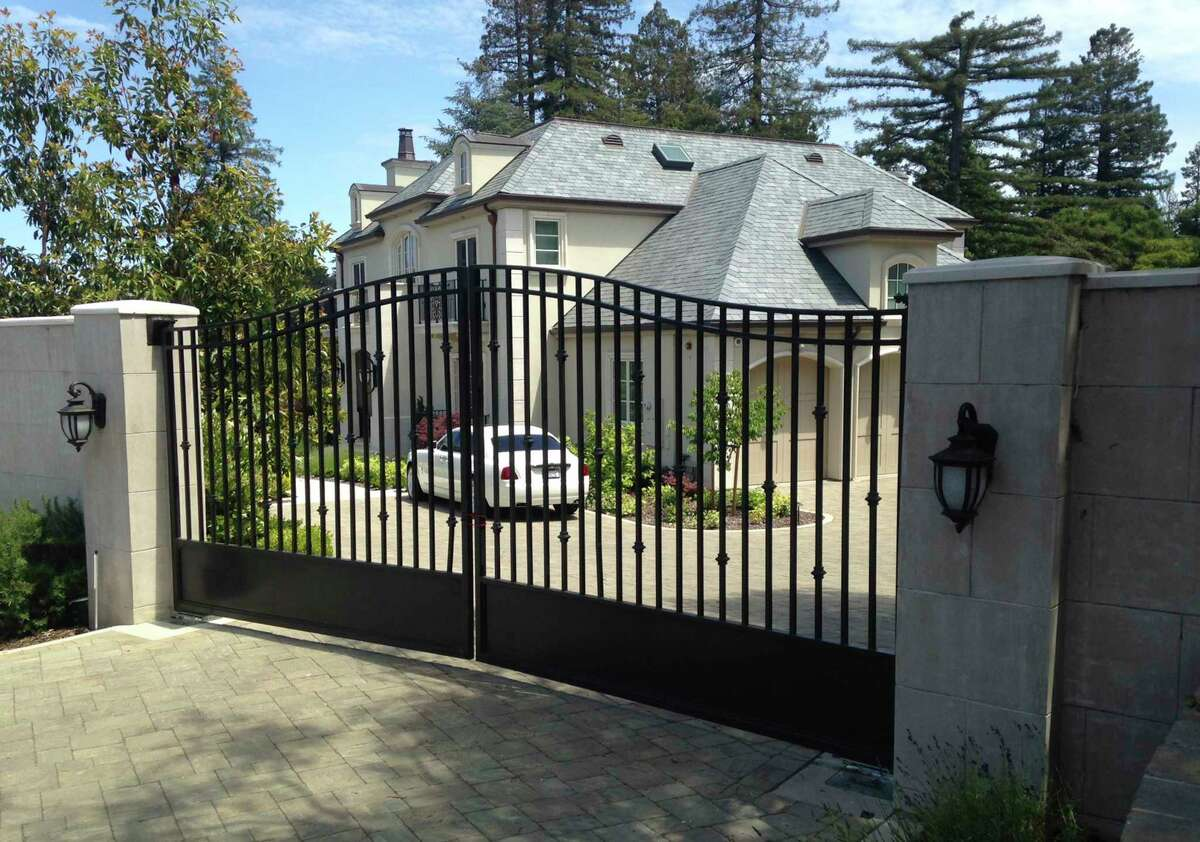 FILE - This May 23, 2016 file photo shows the front gate of the mansion where Tiffany Li lived in Hillsborough, Calif. Li was arrested at the home on suspicion of killing Keith Green, the father of her two children.