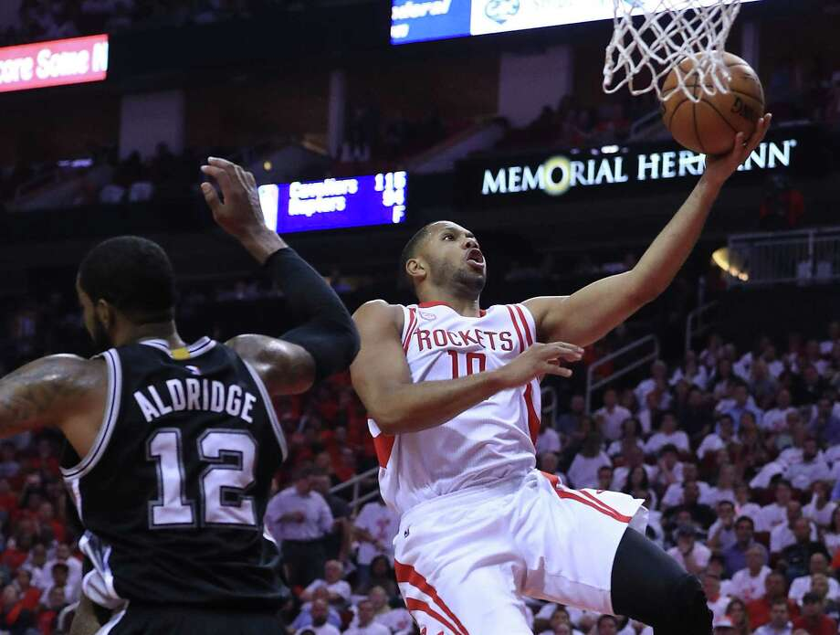 HOUSTON, TX - MAY 05:  Eric Gordon #10 of the Houston Rockets attacks the basket against LaMarcus Aldridge #12 of the San Antonio Spurs during Game Three of the NBA Western Conference Semi-Finals at Toyota Center on May 5, 2017 in Houston, Texas.  NOTE TO USER: User expressly acknowledges and agrees that, by downloading and or using this photograph, User is consenting to the terms and conditions of the Getty Images License Agreement.  (Photo by Ronald Martinez/Getty Images) Photo: Ronald Martinez, Staff / Getty Images / 2017 Getty Images