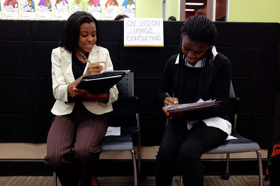Classmates Talia Hall andEri-ife Adepoju, both 16, are looking for summer jobs that will advance their professional goals in medicine and business. Photo: Lydia DePillis