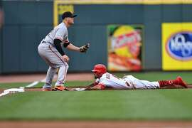 CINCINNATI, OH - MAY 6:  Billy Hamilton #6 of the Cincinnati Reds slides in safely at third for a lead off triple in the first inning as Christian Arroyo #22 of the San Francisco Giants awaits the throw at Great American Ball Park on May 6, 2017 in Cincinnati, Ohio.  (Photo by Jamie Sabau/Getty Images)