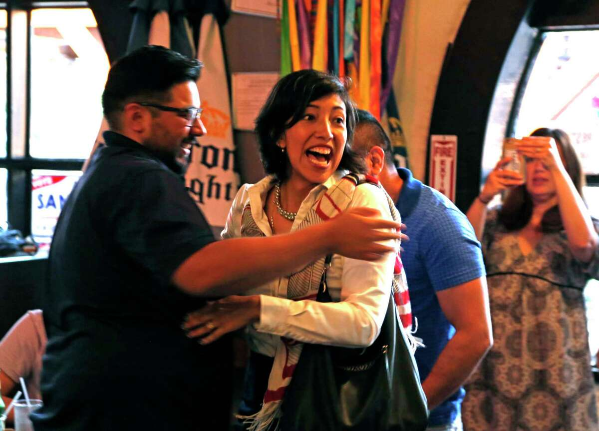 Ana Sandoval reacts after arriving to cheers from supporters including Jesse Salinas,on left, at Deco Pizza. Anna Sandoval is running in District 7 Ana Sandoval could force a runoff in the District 7 race. on Saturday, May 6, 2017.