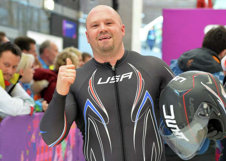 USA-1 four-man bobsleigh, pilot Steven Holcomb celebrates in the Bobsleigh Four-man Heat 4 and final run at the Sanki Sliding Center during the Sochi Winter Olympics on February 23, 2014.    AFP PHOTO / LEON NEALLEON NEAL/AFP/Getty Images ORG XMIT: 461609285 Photo: LEON NEAL / AFP