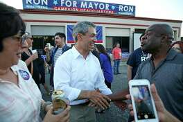 Ron Nirenberg shakes hands with friend Joel Nkemakolam as he celebrates at his campaign headquarters on May 6, 2017.