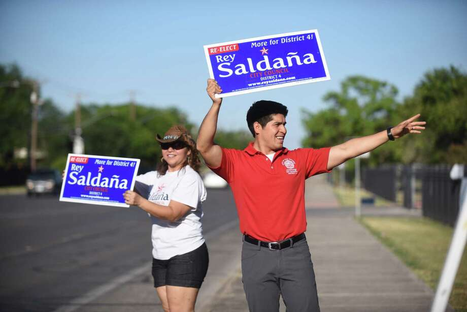 Rey Saldana, District 4 councilman, one of two incumbents to be elected to his fourth and final term on city council, campaigns with his mother, Maricela Saldaña, at Kazan Middle School, which he once attended and is a polling place For the election on Saturday, May 6, 2017. Photo: Billy Calzada, Staff / San Antonio Express-News / San Antonio Express-News