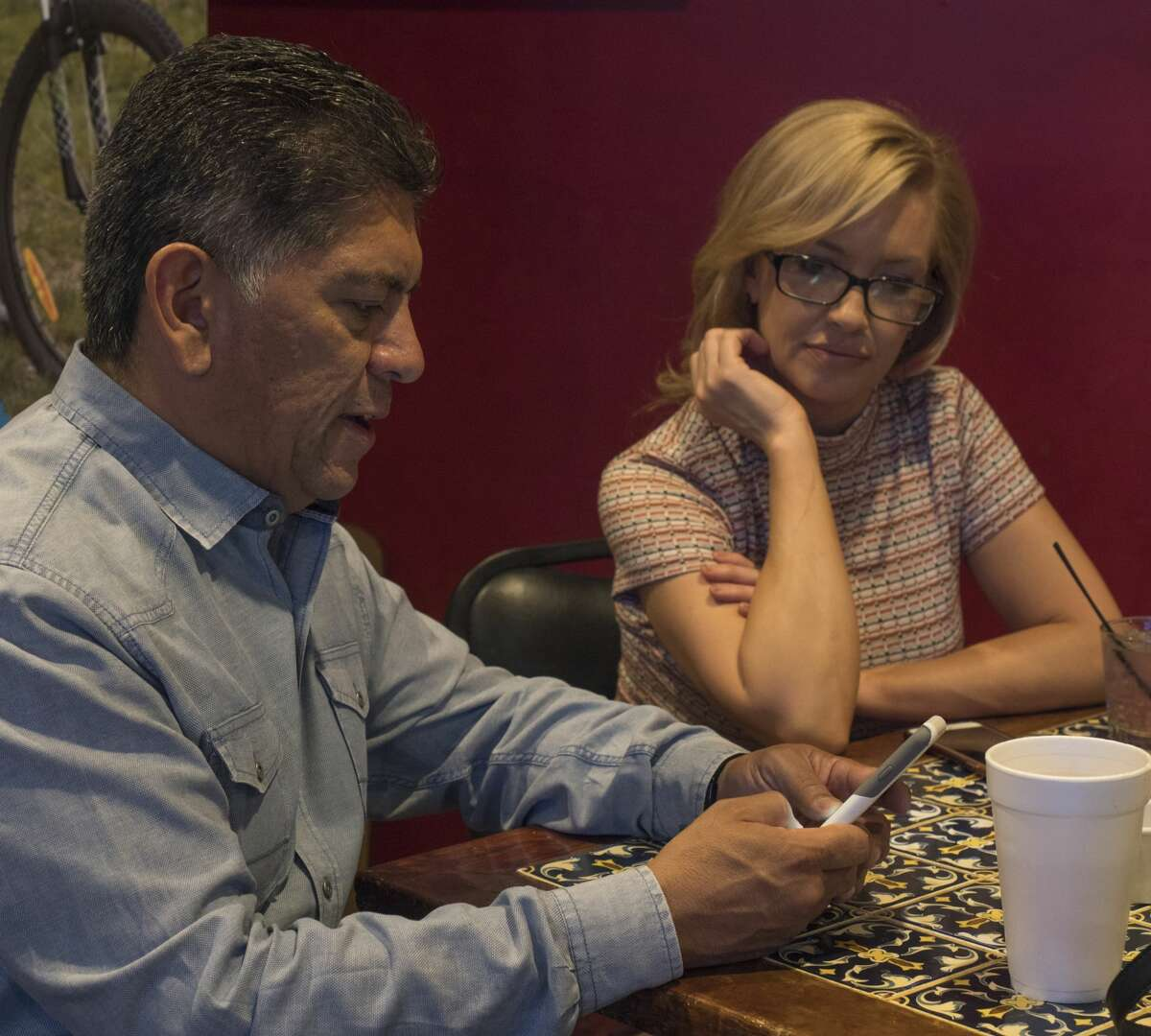 Mayor Jerry Morales checks for election updates 5/06/17 as Michelle Hunt looks on at Gerardos Restaurant. Tim Fischer/Reporter-Telegram