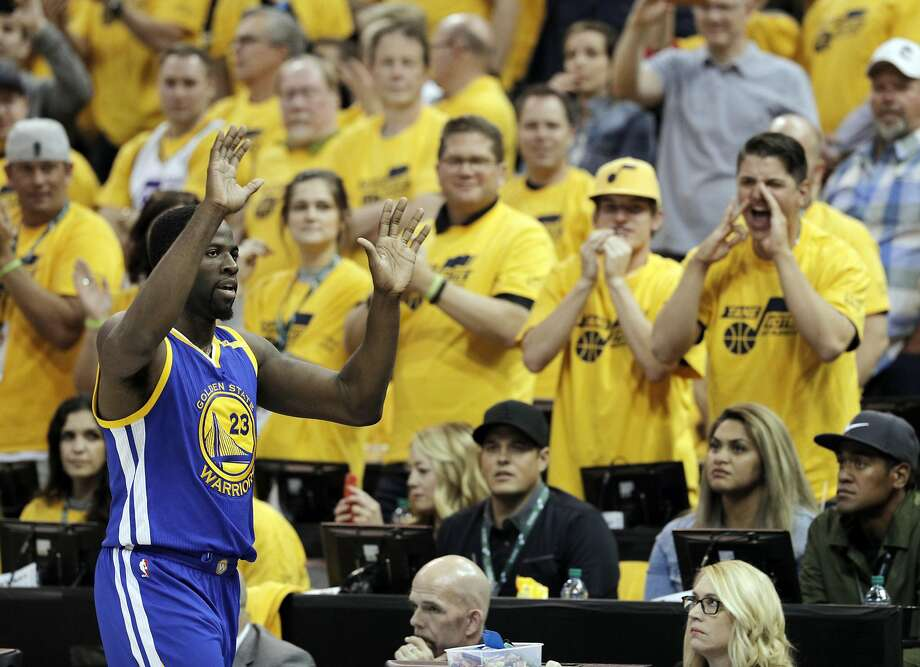 Draymond Green hears it from the fans as he goes to the bench in the first half of the Warriors' Game 3 win at Utah. Green went on to pick up his first technical foul of the playoffs. Photo: Carlos Avila Gonzalez, The Chronicle