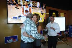 Former mayor Phil Hardberger, left, is embraced by city manager Sheryl Sculley as Christian Archer, leader of OneSA, right, watches as early voting results of San Antonio's proposed $850 million municipal bond, the largest in the city's history, are released on election night, Saturday, May 6, 2017. One of the propositions funds the building of a land bridge over Wurzbach Parkway at Hardberger Park, which is named in honor of the former mayor.