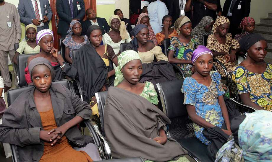 FILE - In this Thursday, Oct. 13, 2016 file photo released by the Nigeria State House, Chibok schoolgirls recently freed from Islamic extremist captivity are seen during a meeting with Nigeria's Vice President Yemi Osinbajo in Abuja, Nigeria. Large numbers of Chibok schoolgirls seized three years ago by Boko Haram have been freed in exchange for detained suspects with the extremist group, Nigeria's government announced early Sunday, May 7, 2017 in the largest release negotiated yet in the battle to save nearly 300 girls whose mass abduction exposed the mounting threat posed by the Islamic State-linked fighters. After the initial release of 21 Chibok girls in October, the government denied making an exchange or paying ransom. (Sunday Aghaeze/Nigeria State House via AP, File) ORG XMIT: NIN102 Photo: Sunday Aghaeze / Copyright 2017 The Associated Press. All rights reserved.