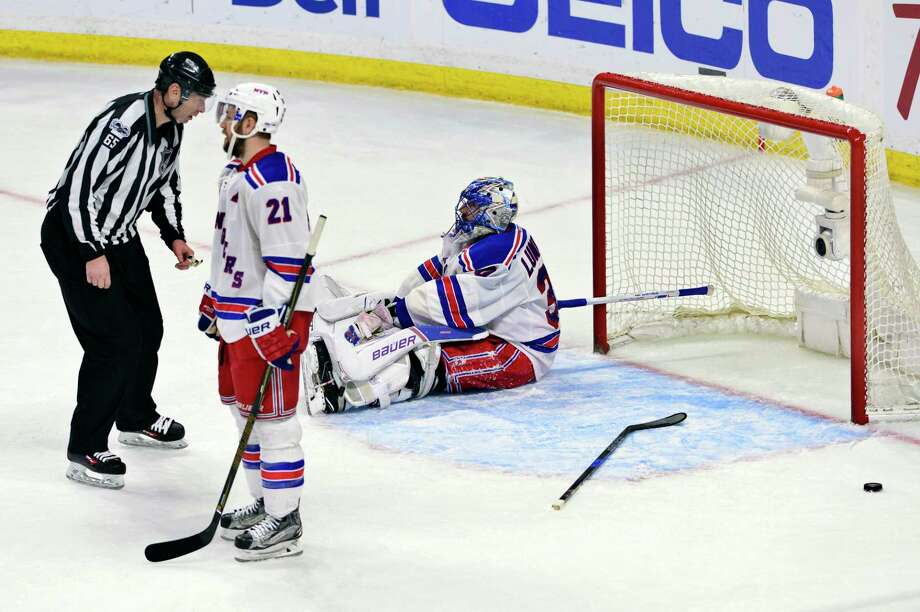 New York Rangers goalie Henrik Lundqvist (30) and center Derek Stepan (21) react after the Ottawa Senators scored to tie the game late in the third period in Game 5 in the second-round of the NHL hockey Stanley Cup playoffs in Ottawa on Saturday, May 6, 2017. (Sean Kilpatrick/The Canadian Press via AP) ORG XMIT: JCO539 Photo: Sean Kilpatrick / The Canadian Press