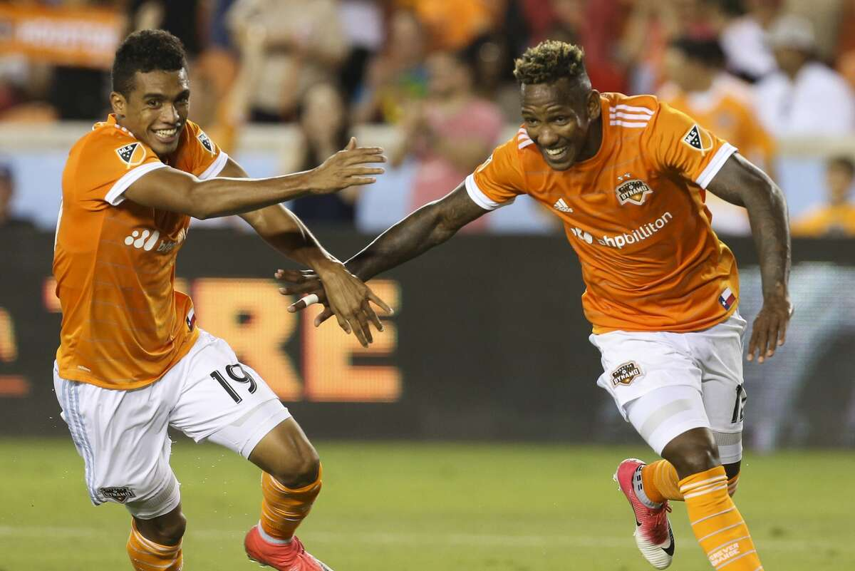 Houston Dynamo forward Mauro Manotas (19) joins Houston Dynamo forward Romell Quioto (12) to celebrate Alberth Elis' goal during the second half of the game at BBVA Compass Stadium Saturday, May 6, 2017, in Houston. Houston Dynamo defeated Orlando City SC 4-0. ( Yi-Chin Lee / Houston Chronicle )