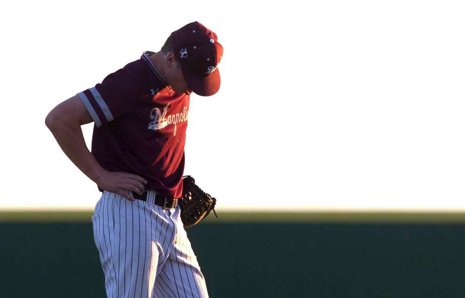 Magnolia starting pitcher Mason Moszkowicz (7) reacts after giving up an 2 RBI single to Austin Smith of Cedar Park during the second inning in Game 3 of a Region III-5A bi-district playoff series at the Mumford Athletic Complex, Saturday, May 6, 2017, in Mumford. Photo: Jason Fochtman, Staff Photographer / © 2017 Houston Chronicle