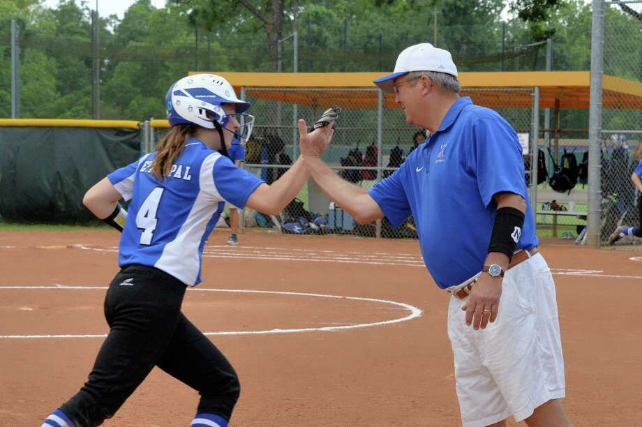 Coach Kim Randolph of Episcopal congratulates Olivia Cusack (4) following a two-run homer in the fourth inning of a varsity softball game between the Episcopal Knights and the Kinkaid Falcons on Friday April 21, 2017 at Perusquia Field, Houston, TX. Photo: Craig Moseley, Staff / ©2017 Houston Chronicle
