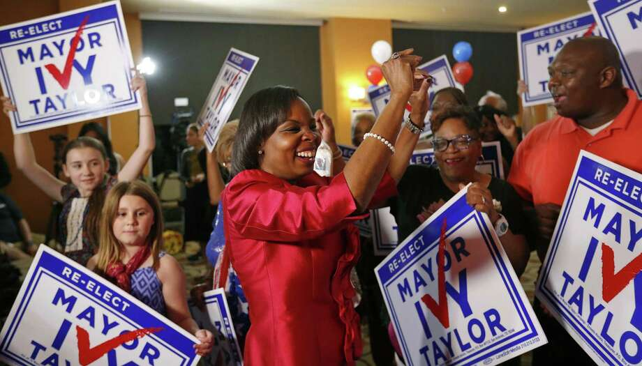 Mayor Ivy Taylor dances with supporters after being interviewed at a watch party held Saturday May 6, 2017 at  at the Wyndam Garden San Antonio Riverwalk Museum Reach Hotel. Photo: Edward A. Ornelas, Staff / San Antonio Express-News / © 2017 San Antonio Express-News