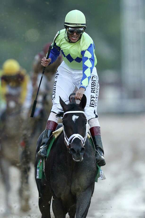 LOUISVILLE, KY - MAY 06:  Jockey John Velazquez celebrates as he guides Always Dreaming #5 across the finish line to win the 143rd running of the Kentucky Derby at Churchill Downs on May 6, 2017 in Louisville, Kentucky.  (Photo by Patrick Smith/Getty Images) ORG XMIT: 696198439 Photo: Patrick Smith / 2017 Getty Images