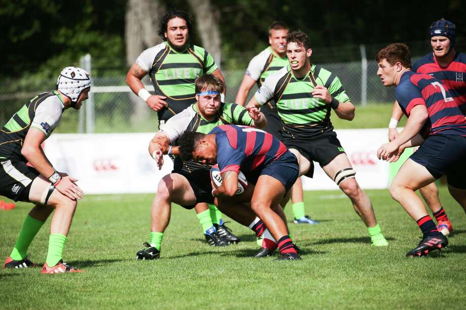St. Mary's College (red / blue) and Life University (Green / Black) play for the college rugby championship on Saturday May 6, 2017 at St. Mary's College in Moraga, Calif.  St. Mary's won 30-24, over Life University for the school's third National Championship in men's rugby. Photo: Saint Mary's College / Saint Mary's College / Saint Mary's College