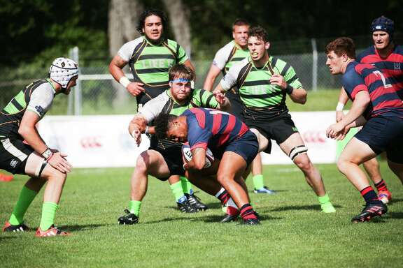 St. Mary's College (red / blue) and Life University (Green / Black) play for the college rugby championship on Saturday May 6, 2017 at St. Mary's College in Moraga, Calif.  St. Mary's won 30-24, over Life University for the school's third National Championship in men's rugby.