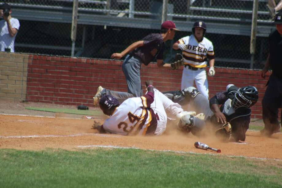 Deer Park's Blake Martin slides home with a score in the second inning Saturday. Despite getting hung up between third and home, Martin scored when the throw from the second baseman was wide. Photo: Robert Avery