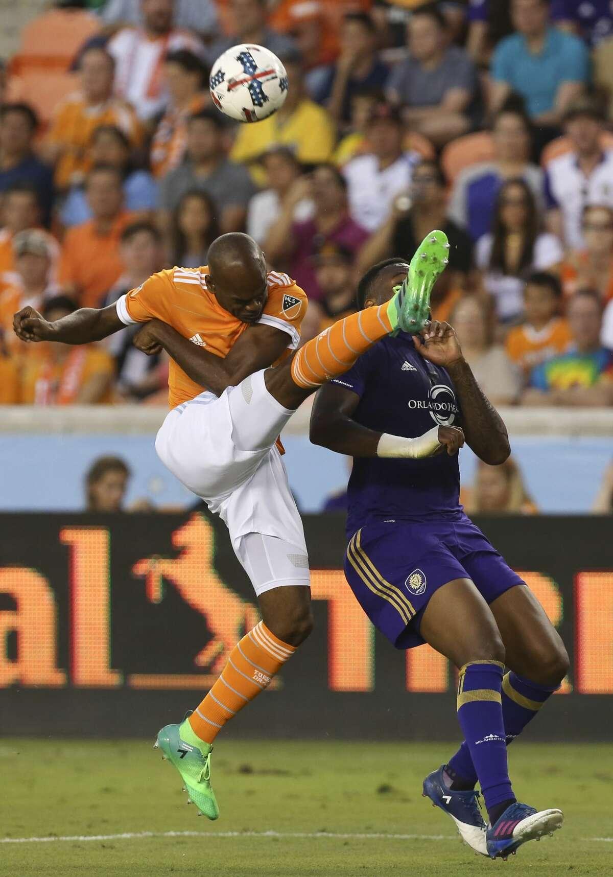 Houston Dynamo defender Adolfo Machado (3) kicks the ball away while defensing Orlando City SC forward Cyle Larin (9) during the first half of the game at BBVA Compass Stadium Saturday, May 6, 2017, in Houston. ( Yi-Chin Lee / Houston Chronicle )