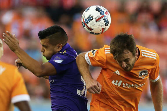 Orlando City SC midfielder Matias Perez Garcia (32) and Houston Dynamo midfielder Eric Alexander (6) battle a header during the first half of the game at BBVA Compass Stadium Saturday, May 6, 2017, in Houston. ( Yi-Chin Lee / Houston Chronicle )