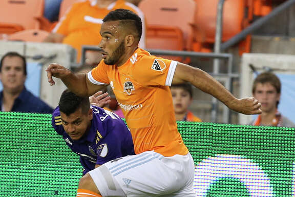 Houston Dynamo midfielder Alex (14) steals the ball from Orlando City SC midfielder Matias Perez Garcia (32) during the first half of the game at BBVA Compass Stadium Saturday, May 6, 2017, in Houston. ( Yi-Chin Lee / Houston Chronicle )