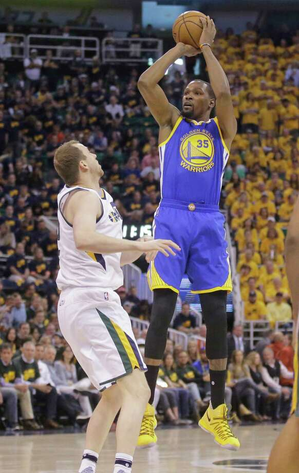 Golden State Warriors forward Kevin Durant (35) shoots as Utah Jazz forward Joe Ingles, left, defends in the first half during Game 3 of the NBA basketball second-round playoff series Saturday, May 6, 2017, in Salt Lake City. (AP Photo/Rick Bowmer) ORG XMIT: UTRB103 Photo: Rick Bowmer / Copyright 2017 The Associated Press. All rights reserved.