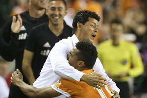Houston Dynamo forward Mauro Manotas (19) picks up head coach Wilmer Cabrera after scoring his second goal during the second half of the game at BBVA Compass Stadium Saturday, May 6, 2017, in Houston. Houston Dynamo defeated Orlando City SC 4-0. ( Yi-Chin Lee / Houston Chronicle )