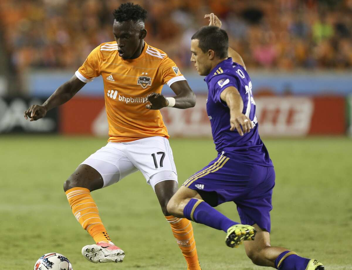 Houston Dynamo forward Alberth Elis (17) is defensed by Orlando City SC defender Donny Toia (25) during the second half of the game at BBVA Compass Stadium Saturday, May 6, 2017, in Houston. Houston Dynamo defeated Orlando City SC 4-0. ( Yi-Chin Lee / Houston Chronicle )