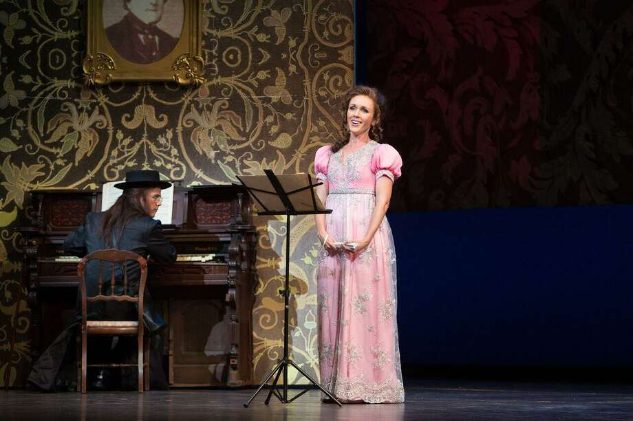 "Soprano Sarah Coburn, portraying Rosina, takes a music lesson from Count Almaviva, played by tenor Andrew Owens, in Opera San Antonio's ""The Barber of Seville."" Photo: Marty Sohl Photography / Marty Sohl Photography"