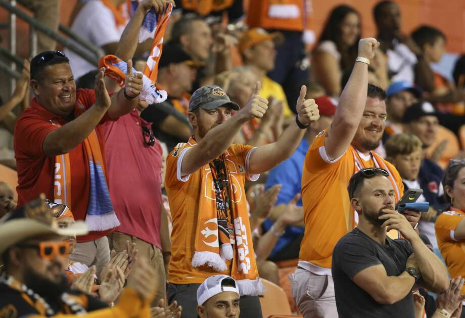 Traveling dynamo fans sanctioned by fc dallas stadium security photos a comparison of houston and dallas sportshouston dynamo fans cheer for houston dynamo forward malvernweather Image collections