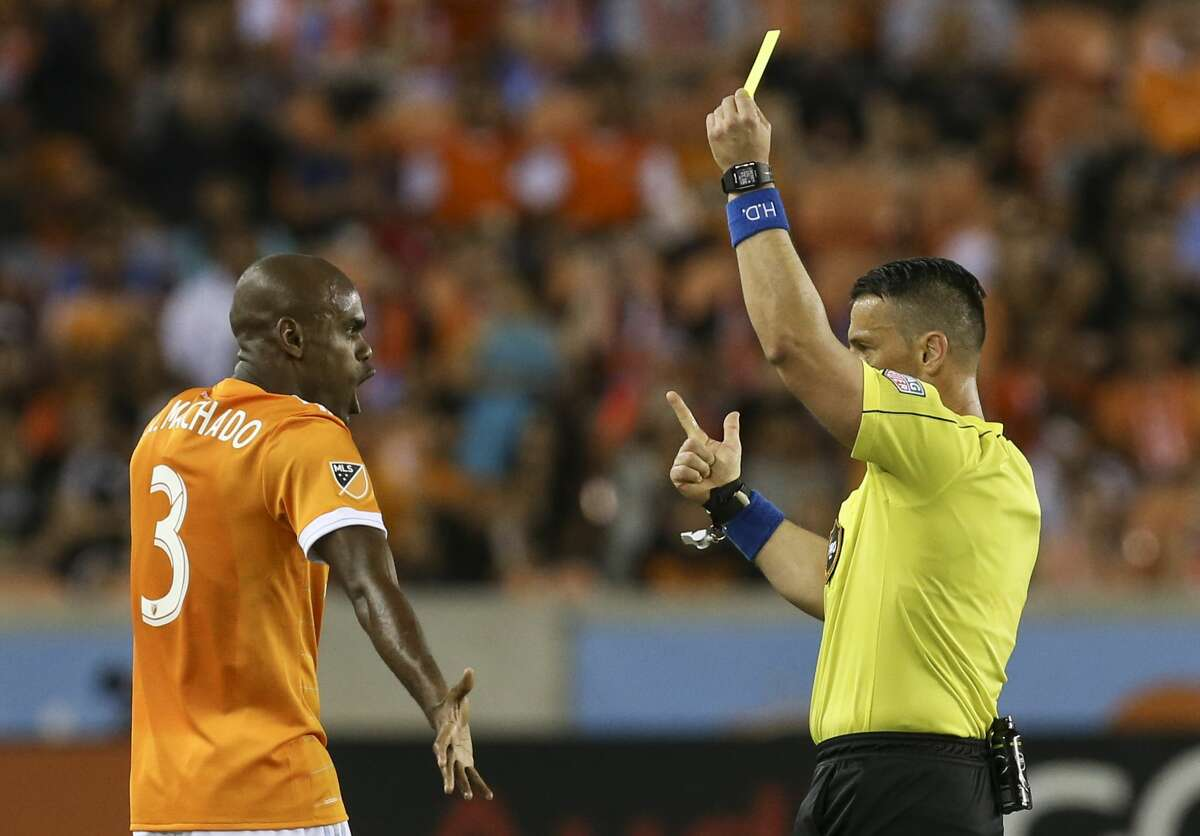 Houston Dynamo defender Adolfo Machado (3) argues with referee Sorin Stoica for receiving a yellow card during the second half of the game at BBVA Compass Stadium Saturday, May 6, 2017, in Houston. ( Yi-Chin Lee / Houston Chronicle )