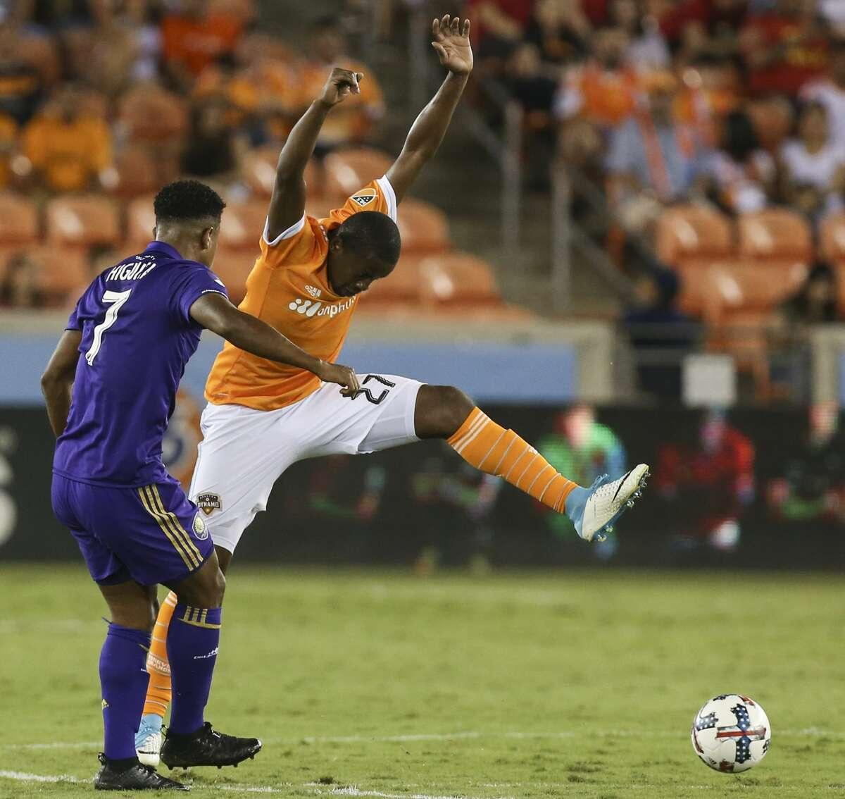 Houston Dynamo midfielder Boniek Garcia (27) jumps as Orlando City SC midfielder Cristian Higuita (7) makes a pass during the second half of the game at BBVA Compass Stadium Saturday, May 6, 2017, in Houston. ( Yi-Chin Lee / Houston Chronicle )