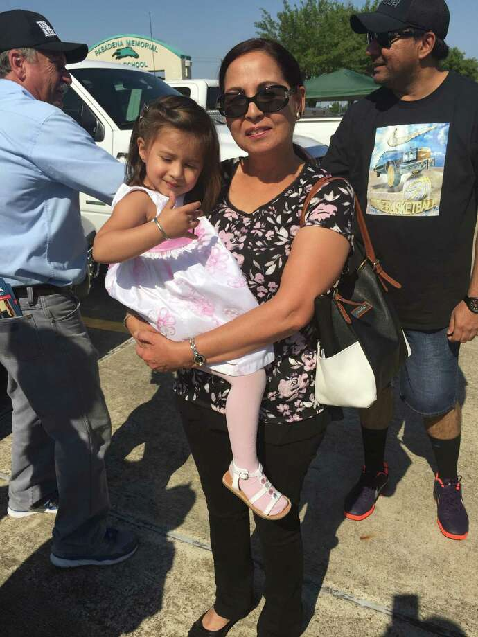 Grandmother and first-time voter in the Pasadena municipal election, Amber Memon, and her two year-old granddaughter, was all smiles outside the polls at Pasadena Memorial High School on Election Day.  Photo: Kristi Nix / handout