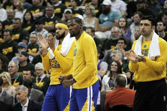 Kevin Durant (35) flexes after a play went the Warriors way in the first half as the Golden State Warriors played the Utah Jazz at Vivint Smart Home Arena in Salt Lake City, Utah, on Saturday, May 6, 2017, in Game 3 of the 2017 Western Conference Semifinals.